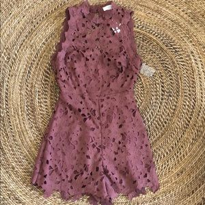 ASTR the cutest romper and has an open back